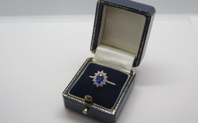 An 18ct white gold sapphire and diamond ring, size L, approx...