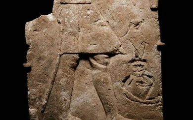 An Egyptian Limestone Sculptor's Model or Votive Relief