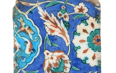 An Isnik Pottery Tile, circa 1580, typically painted in red,...