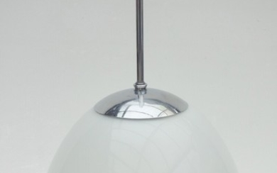 An opal glass bell pendant with chrome-plated metal suspension, bakelite socket. Manufactured by Louis Poulsen. H. 37 cm. Diam. 30 cm.