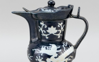 CHINESE WHITE-ON-BLUE PORCELAIN EWER In monk's-cap form, with a five-clawed dragon and lotus design. Six-character Ming mark on base..