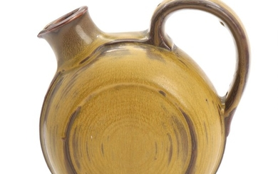 Carl Halier: A Royal Copenhagen stoneware pitcher decorated with green-yellowish glaze. Signed monogram. H. 17 cm.