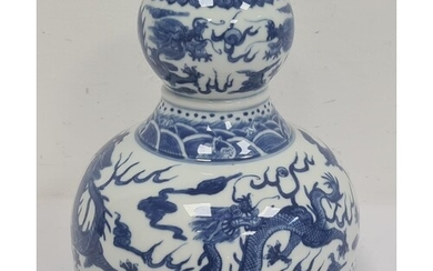 Chinese porcelain double-gourd vase with broad flat base and...