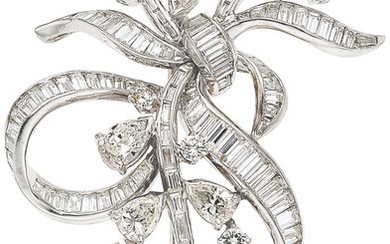 Diamond, White Gold Pendant-Brooch The brooch features pear-shaped diamonds...