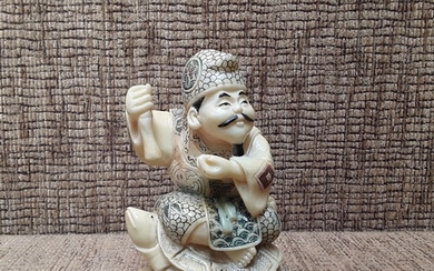 Ivory Chinese/ Japanese carved man sat on turtle 11cm