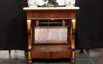 Nineteenth century so-called trumeau : a console with drawer in acajou decorated with decorated bronze fittings, with mirror back and white marble top - ca 1825 |||19th Cent. console/bracket with drawer in mahogany with mountings in guilded bronze