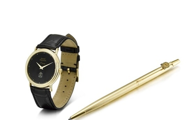 PIAGET | REFERENCE 12332 A YELLOW GOLD WRISTWATCH WITH HAWK OF QURAYSH DIAL AND A GOLD PLATED BALL POINT PEN, CIRCA 1990
