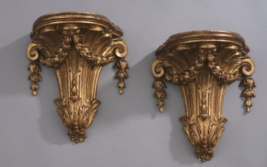Pair of carved and gilded wood sconces, the...