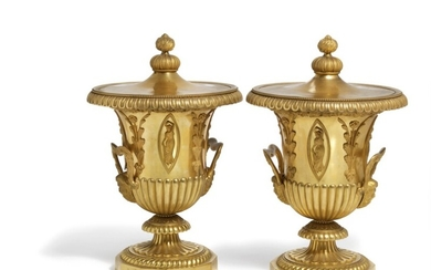 Pierre Philippe Thomire: A pair of Empire gilt bronze campana vases with covers. Stamped 'THOMIRE'. Early 19th century. (2)