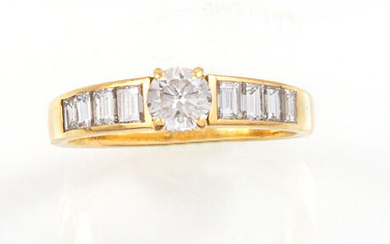 RING in 18K yellow gold set with one brilliant cut...