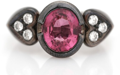 NOT SOLD. Stenstrup Juveler: A rhodolite and diamond ring set with a rhodolite flanked by...