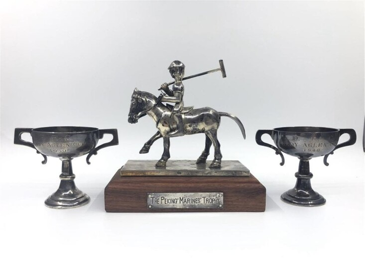 THE SILVER TROPHIES FROM THE MARINE CORPS JOCKEY C