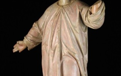 A 17th/18th Century Carved & Polychromed Limewood Figure of the Young Christ Child depicted with wav