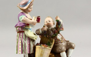 A 19TH CENTURY MEISSEN PORCELAIN GROUP OF A YOUNG BOY