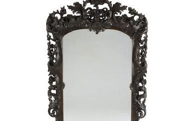 A Baroque Style Carved Walnut Mirror