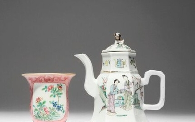 A CHINESE FAMILLE ROSE WALL VASE AND A HEXAGONAL-SECTION TEAPOT AND COVER LATE QING DYNASTY/REPUBLIC PERIOD The wall vase painted with a panel of flowering branches, all reserved on a pink ground decorated with scrolling designs, the teapot painted...