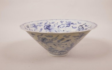 A Chinese blue and white porcelain conical bowl with a lobed...