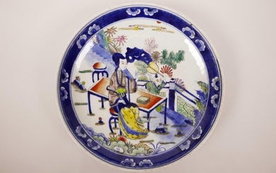 A Chinese blue and white porcelain dish with polychrome enam...