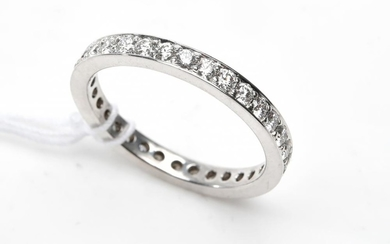 A DIAMOND ETERNITY RING IN 18CT WHITE GOLD