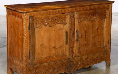 A French Provincial carved pine buffet