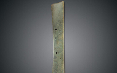 A GREYISH-GREEN JADE CEREMONIAL BLADE, DAO, NEOLITHIC PERIOD, QIJIA CULTURE, CIRCA 2050-1700 B.C.