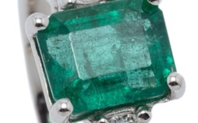 A PLATINUM EMERALD AND DIAMOND RING; bead claw set with an emerald cut emerald of approx. 1.72ct to shoulders each set with a round...