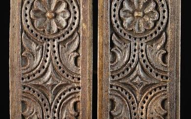 A Pair of Good 17th Century Pierced Oak Ventilated Panels carved with symmetrical daisy wheels flank
