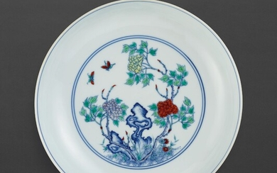 A RARE DOUCAI 'FLOWER AND BUTTERFLY' DISH MARK AND PERIOD OF YONGZHENG