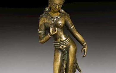 A SOLID CAST BRONZE FEMALE DEITY.
