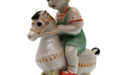 A SOVIET PORCELAIN FIGURINE BOY RIDING A HORSE ZHK