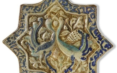 A STAR-SHAPED KASHAN TILE, PERSIA, 13TH-14TH CENTURY