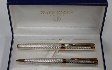 A Waterman silver and gilt metal pen set, comprising roller ball and ballpoint, cased.