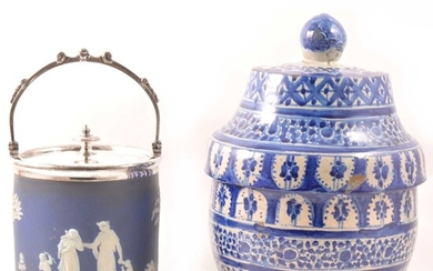 A Wedgwood blue jasperware biscuit box, and a Continental storage jar