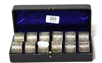 A cased set of twelve Victorian silver plated napkin rings,...