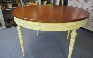 A circular hardwood dining table of French style, turned, ta...