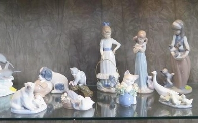 A collection of Lladro and Nao figures of children, polar be...