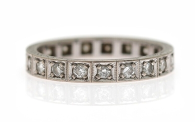 A diamond eternity ring set with numerous brilliant-cut diamonds weighing a total of app. 0.38...