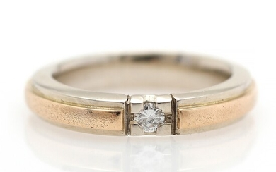 A diamond ring set with a brilliant-cut diamond weighing app. 0.09 ct., mounted in 14k...