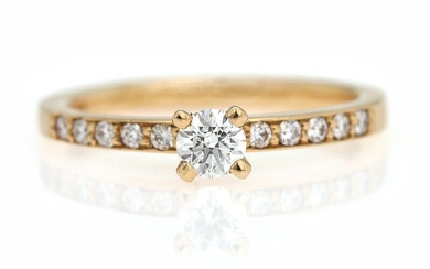 NOT SOLD. A diamond ring set with a brilliant-cut diamond weighing app. 0.21 ct. flanked...
