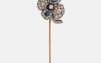 A four-leaf diamond and sapphire stick pin in platinum and 14K gold