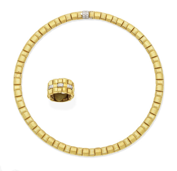 A gold and diamond necklace and ring suite