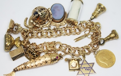 A gold charm bracelet featuring nine 9ct gold charms approx....