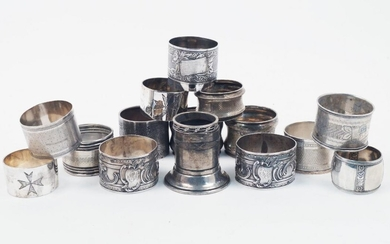 A group of seven various French silver napkin rings, together...