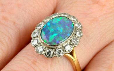 A mid 20th century 18ct gold black opal and brilliant-cut diamond cluster ring.