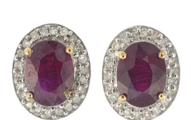 A pair of 9ct gold glass-filled ruby and diamond cluster earrings.