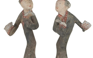 A pair of Chinese painted grey pottery figures of...