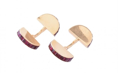 A pair of French ruby cufflinks by Cartier