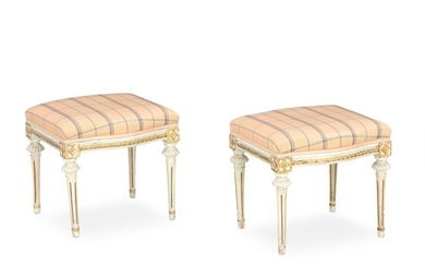 A pair of Gustavian white painted and giltwood stools. Late 28th century. (2) – Bruun...
