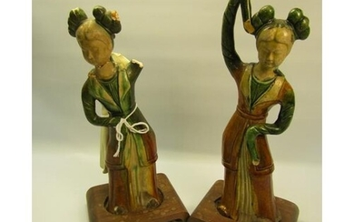 A pair of Tang Dynasty style pottery figures of ladies in co...