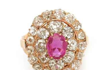 A ruby and diamond ring set with an oval-cut ruby encircled by numerous old-cut diamonds totalling app. 3.5 ct., mounted in 18k rose gold. Size 53.